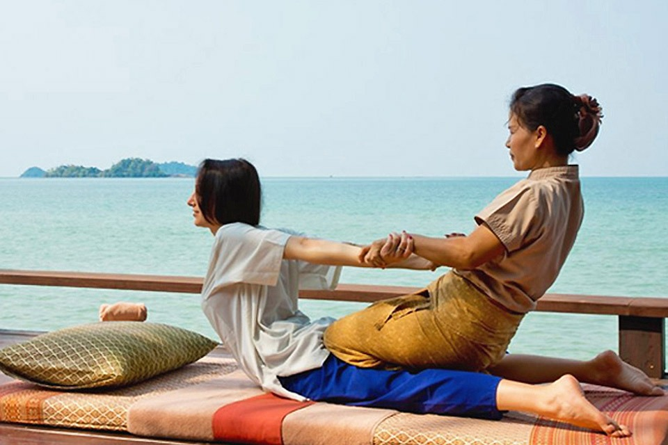 Woman receiving Thai Yoga Massage from practitioner